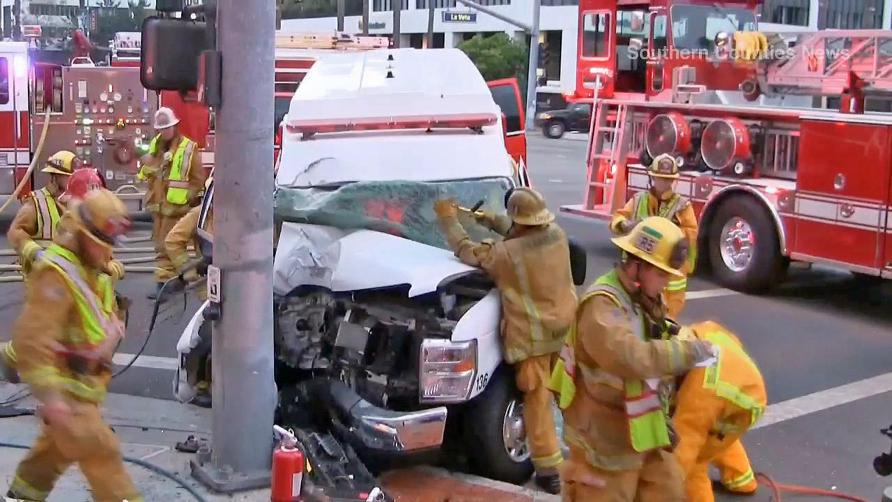 Crews are seen after an ambulance crashed into a pole outside Childrens Hospital of Orange County on Sunday, Oct. 13, 2013. Two people inside were rescued and had minor injuries.