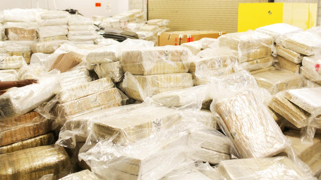 Tustin Police found approximately 12 tons of marijuana packaged in bricks and hidden in boxes among electronics in a tractor-trailer Monday morning, Dec. 2, 2013. The marijuanas wholesale value was estimated at more than $7 million.
