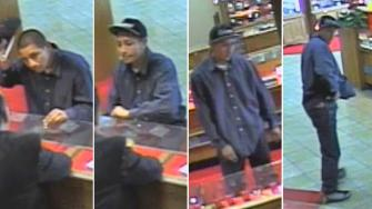 Surveillance still images show an armed robbery suspect behind a heist at a Santa Ana jewelry store on Tuesday, Dec. 3, 2013.