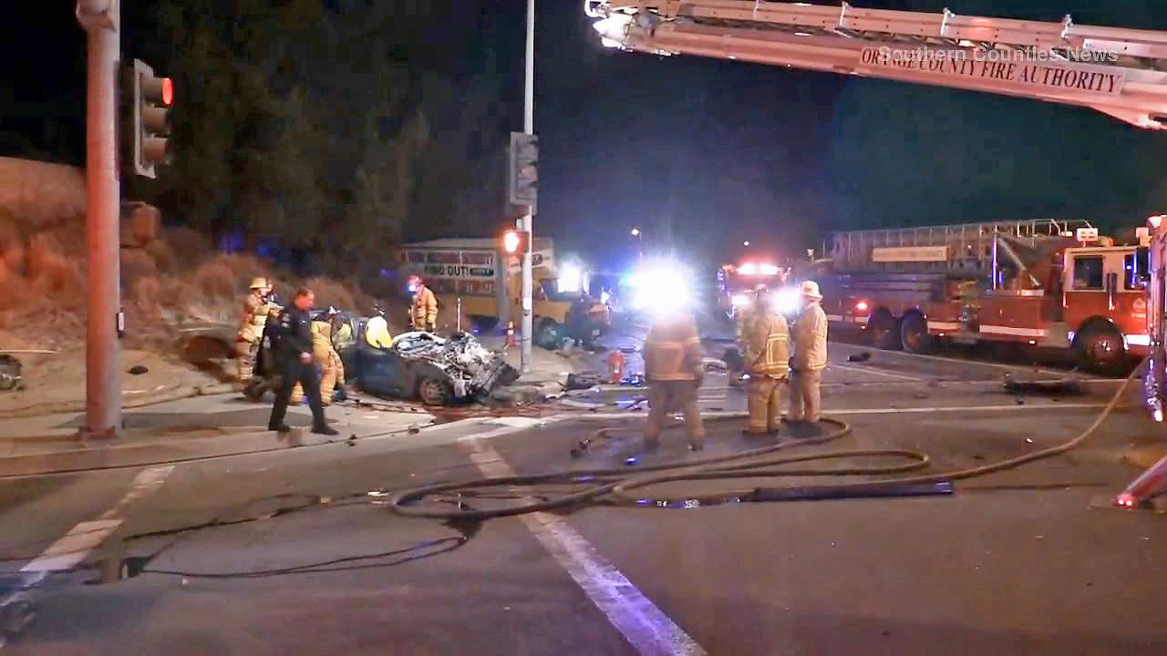 Crews at the scene of a violent car crash in Placentia that killed two people on Sunday, Dec. 15, 2013.