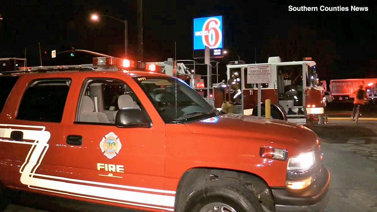 A fire department vehicle is shown outside of a Motel 6 in the city of Orange on Friday, Feb. 14, 2014.