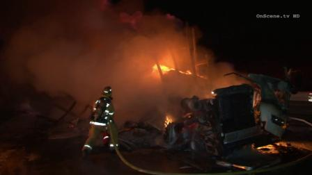 A big rig carrying mail went up in flames on Tuesday, Mar. 4, 2014 on the 57 Freeway in Brea.