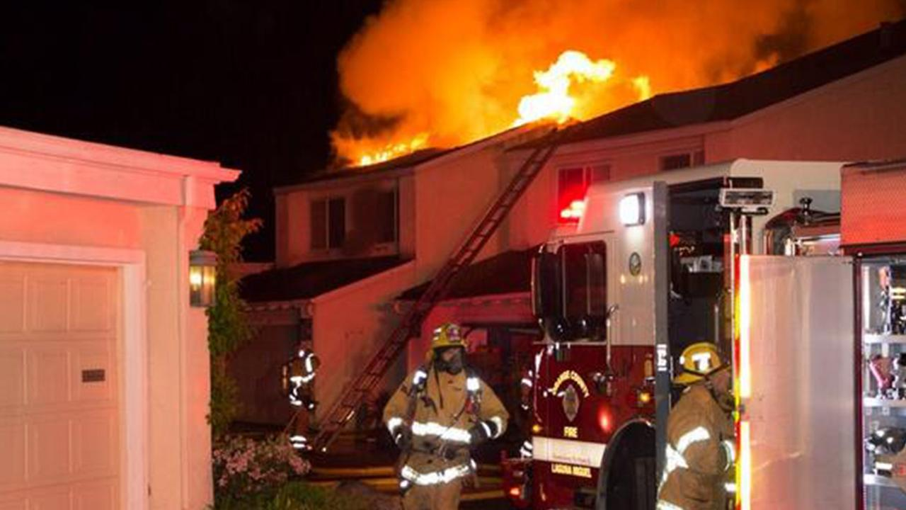 Orange County firefighters battle a fire spreading across two Laguna Niguel condominiums Monday, March 24, 2014.