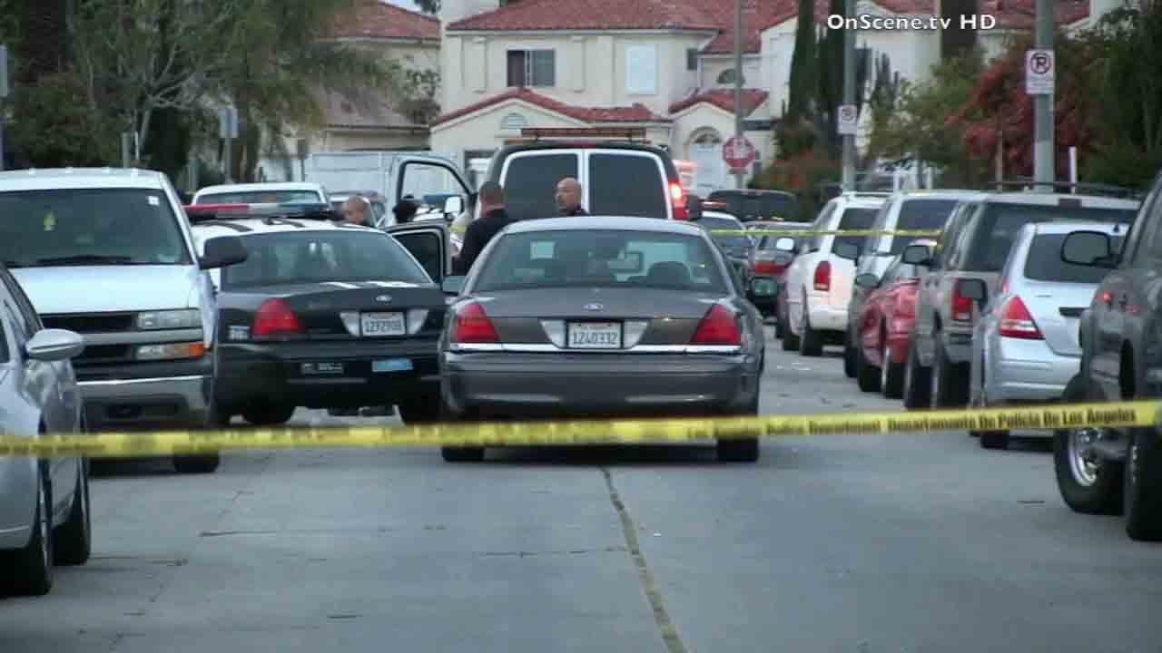 Los Angeles police respond to the scene of an officer-involved shooting on the 10000 block of South Grape Street in the Watts area Saturday, March 29, 2014.