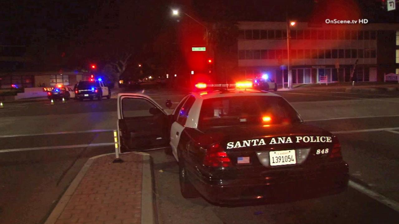 Police investigate after a child was struck by a truck in Santa Ana on Sunday, March 30, 2014.