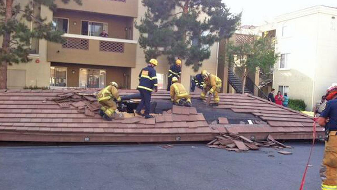 Authorities on the scene of a carport collapse in Mission Viejo on Saturday, April 19, 2014.