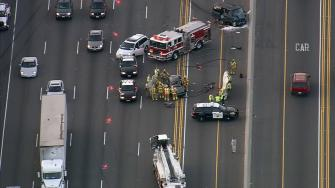 Two people were killed and five others injured in a traffic accident on the northbound 5 Freeway in Irvine Thursday, April 24, 2014.