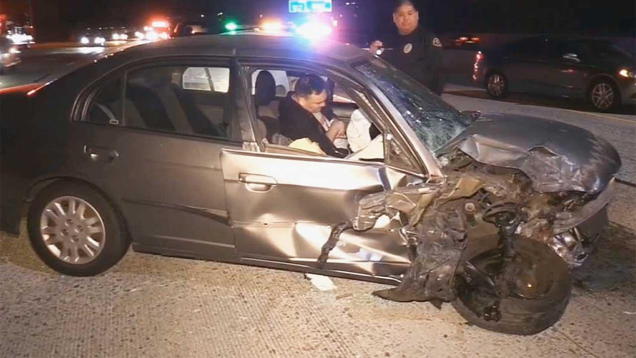 Authorites arrive on scene after a suspected drunk driver caused a head-on crash while driving the wrong way on the Garden Grove (22) Freeway.