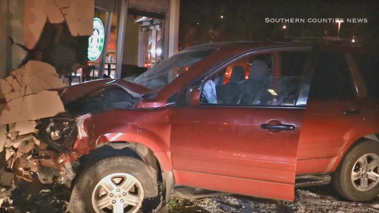 A man crashed into a Starbucks in Newport Beach, then tried to flee on foot with a small child on Thursday, May 1, 2014.
