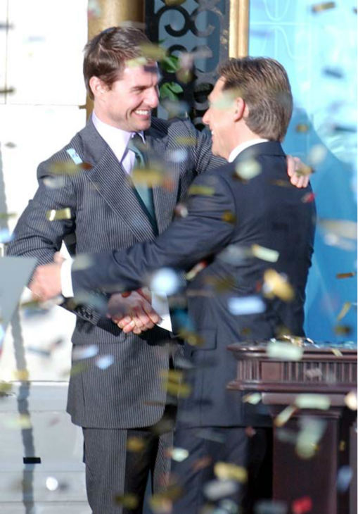Confetti rains down as U.S. actor Tom Cruise, left, embraces David Miscavige, the Scienology Church&#39;s President of the Rulling Council during the official opening of a new Scientology church in central Madrid Saturday Sept. 18, 2004. <span class=meta>(AP Photo&#47;Paul White)</span>