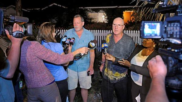 Jeff Casher, left, and Bill Bennett, technical support staff members for the Sunderland family, talk to reporters outside the Sunderland home, Thursday, June 10, 2010, in Thousand Oaks, Calif.