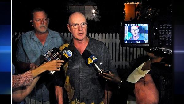 Jeff Casher, left, and Bill Bennett, technical support staff members for the Sunderland family, talk to reporters outside the Sunderland home, Thursday, June 10, 2010, in T