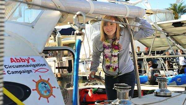 Abby Sunderland, 16, looks out from her sailboat Wild Eyes as she leaves for her world record attempting journey Saturday, Jan 23, 2010, in Marina del Rey, Calif.