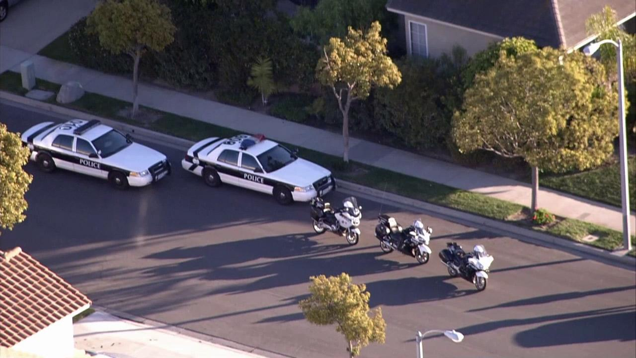 Police vehicles are parked in a neighborhood around Naples Drive and Northport Lane in Oxnard, where two pursuit suspects fled on foot on Thursday, Jan. 3, 2013.