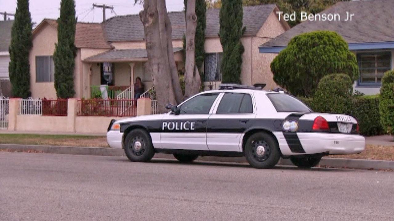 A police patrol vehicle is shown at the scene where the bodies of a man and a woman were found in a car in the 600 block of South D Street in Oxnard on Saturday, May 4, 2013.