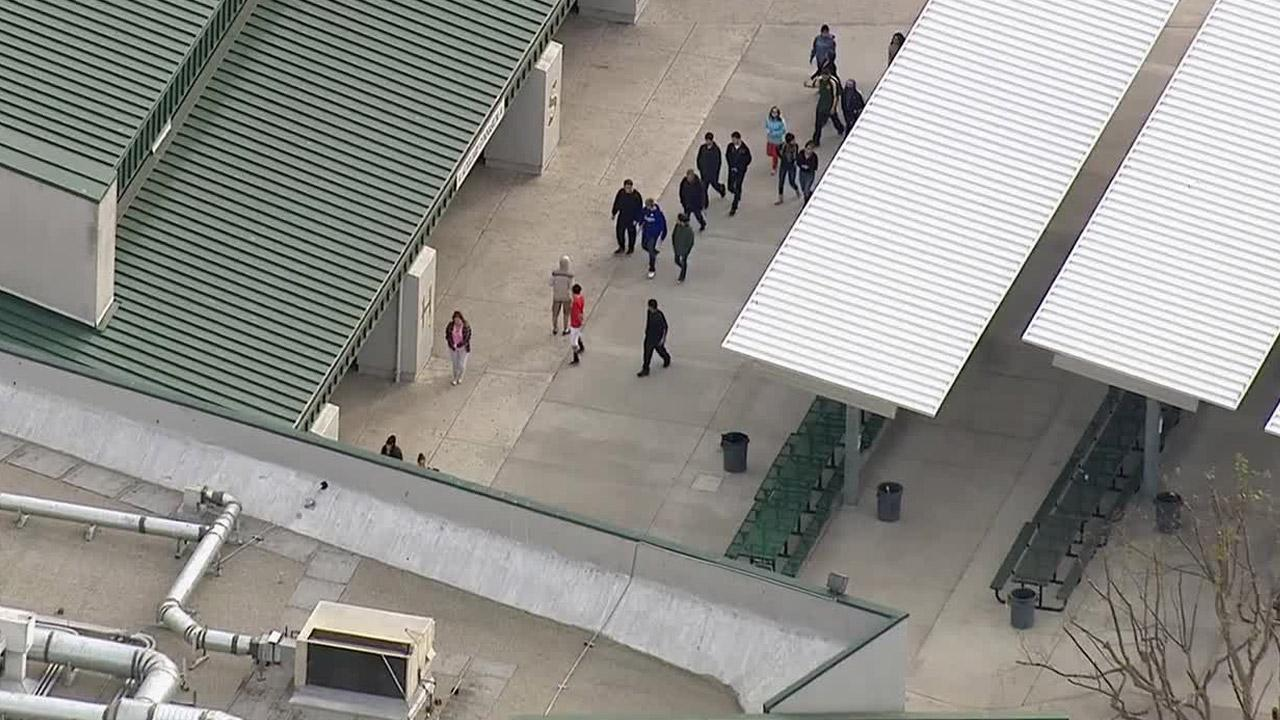 Students are seen being cleared from a part of Moorpark High School after a threat was made on Thursday, Dec. 19, 2013.