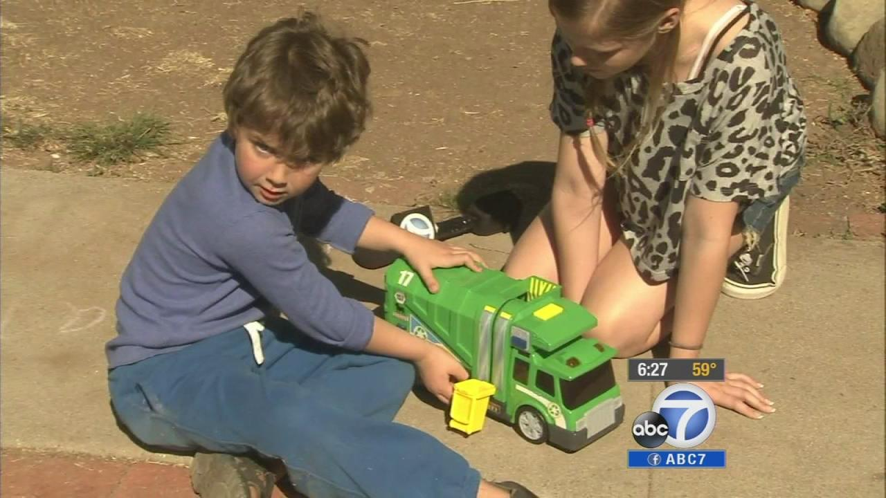 Daniel Mulligan, 5, plays with his toy trash truck.