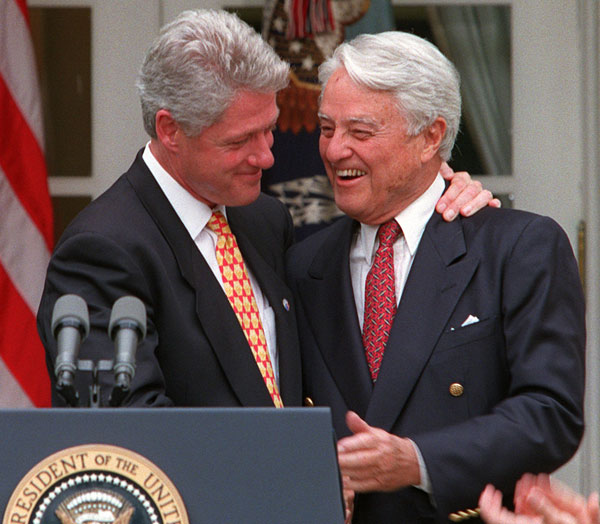 President Clinton embraces R. Sargent Shriver in the Rose Garden of the White House Wednesday June 19, 1996 during a ceremony to honor the 35th anniversary of the Peace Corps. Shriver died on Tuesday, Jan. 18, 2011, at the age of 95. <span class=meta>(AP Photo&#47;Ruth Fremson)</span>