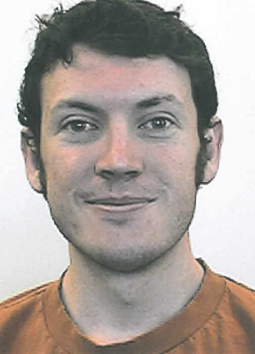 James Holmes, 24, of North Aurora, is shown in...