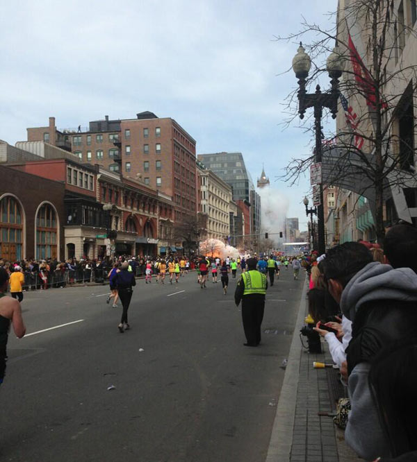 "<div class=""meta ""><span class=""caption-text "">Two bombs exploded near the finish of the Boston Marathon on Monday, killing two people and injuring 23 others.  About two hours after the winners crossed the line, there was a loud explosion on the north side of Boylston Street, just before the photo bridge that marks the finish line. Another explosion could be heard a few seconds later.  Competitors and race volunteers were crying as they fled the chaos. Bloody spectators were being carried to the medical tent that had been set up to care for fatigued runners. Authorities went onto the course to carry away the injured while stragglers in the 26.2-mile race were rerouted away from the smoking site. (Courtesy of Dan Lampariello)</span></div>"
