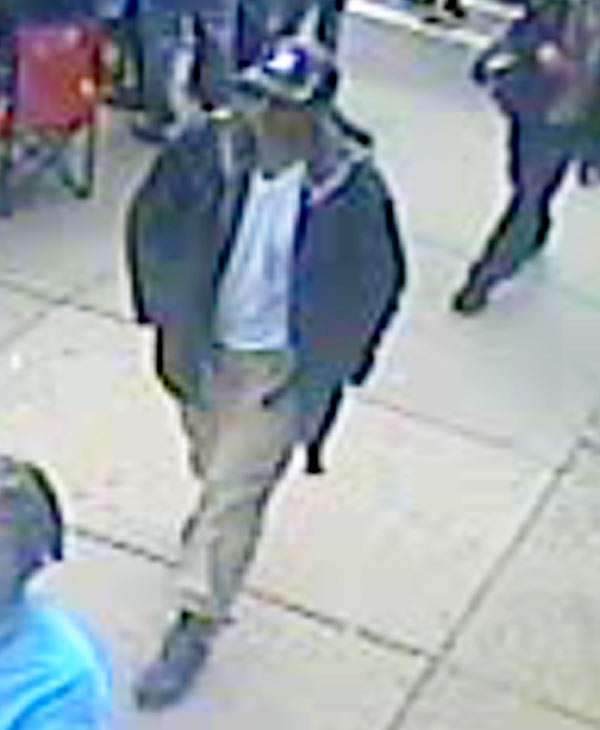 This image from surveillance video released by the FBI on Thursday, April 18, 2013, shows what the FBI are calling suspect number 1, in black cap, walking through the crowd in Boston on Monday, April 15, 2013, before the explosions at the Boston Marathon. <span class=meta>(FBI)</span>