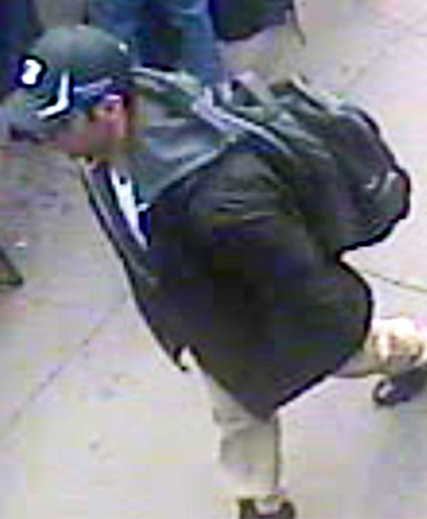 "<div class=""meta image-caption""><div class=""origin-logo origin-image ""><span></span></div><span class=""caption-text"">This image from surveillance video released by the FBI on Thursday, April 18, 2013, shows what the FBI are calling suspect number 1, in black cap, walking through the crowd in Boston on Monday, April 15, 2013, before the explosions at the Boston Marathon. (FBI)</span></div>"