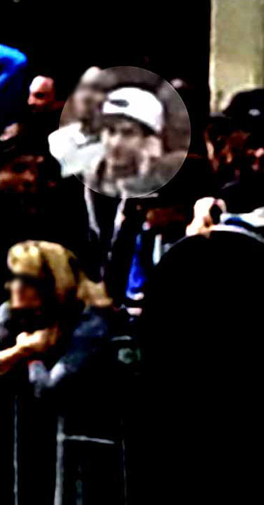 "<div class=""meta ""><span class=""caption-text "">This image from surveillance video released by the FBI on Thursday, April 18, 2013, shows what the FBI are calling suspect number 2, in white cap, center, walking behind suspect number 1, not seen, through the crowd in Boston on Monday, April 15, 2013, before the explosions at the Boston Marathon. (FBI)</span></div>"