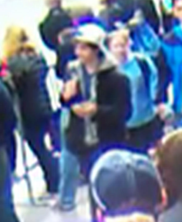 This image from surveillance video released by the FBI on Thursday, April 18, 2013, shows what the FBI are calling suspect number 2, in white cap, center, walking behind suspect number 1, not seen, through the crowd in Boston on Monday, April 15, 2013, before the explosions at the Boston Marathon. <span class=meta>(FBI)</span>