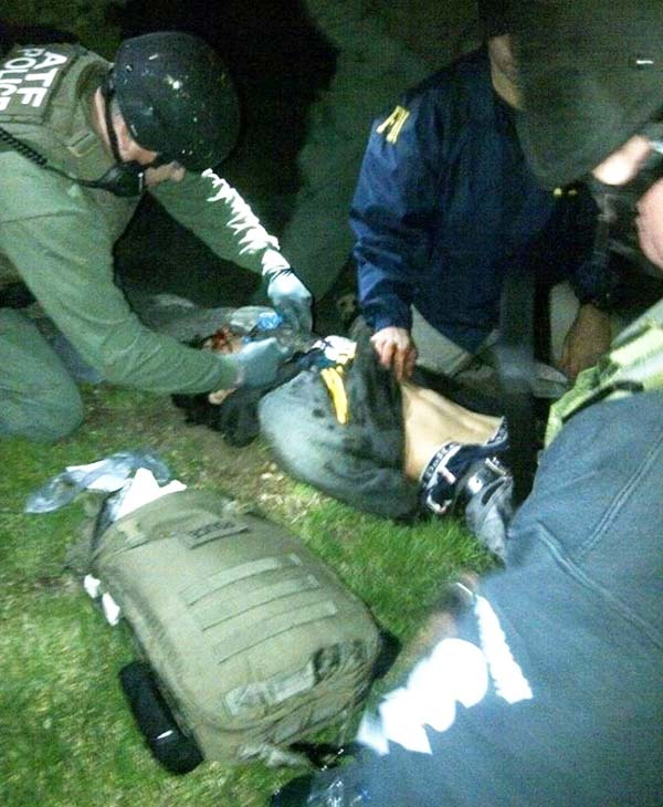 ATF medic working on Boston Marathon bombing suspect Dzhokhar Tsarnaev moments after he was captured in Watertown, Mass., on Friday, April 19, 2013.