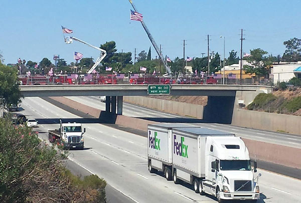 "<div class=""meta ""><span class=""caption-text "">Flags are put on display at the San Gorgonio overpass and the 10 Freeway in Banning for the 12th anniversary of the Sept. 11 terrorist attacks. (Troy Case)</span></div>"