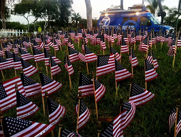 A Sept. 11 tribute is seen outside Orange County Fire Authority firefighter Scott Townley&#39;s home in Fullerton on Wednesday, Sept. 11, 2013.  <span class=meta>(KABC &#47; Edgar Alcala)</span>