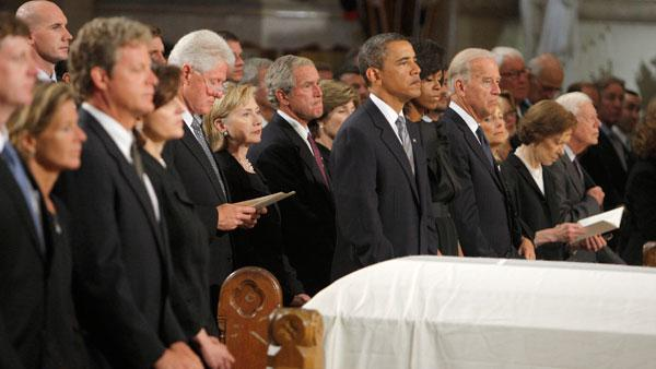 The casket of Senator Edward Kennedy sits between his family, from left, Kara Kennedy Allen, Edward Kennedy Jr., Vicki Reggie Kennedy, former President Bill Clinton, Secretary of State Hillary Clinton, former President George W. Bush and former first lady Laura, President Barack Obama and first lady Michelle Obama, Vice President Joseph Biden and h