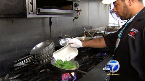 Even though New Orleans has only 78 percent of its pre-Katrina population, it has more restaurants now than before the storm. Pictured above, a chef at Drago's Restaurant is seen preparing a dish.