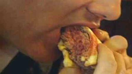 A man bites into a burger in this undated file photo.
