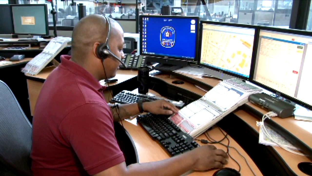 A dispatcher is seen at a 911 call center in this undated file photo.