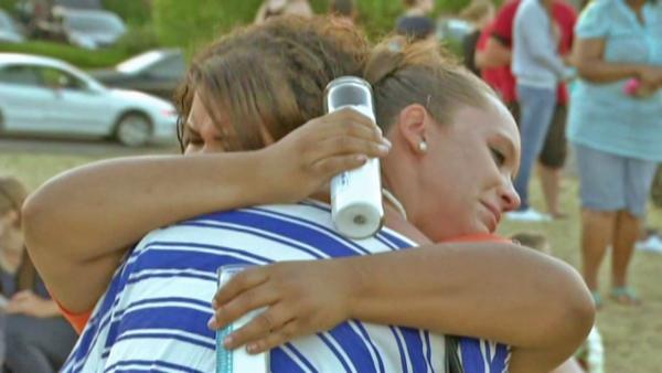 Aurora theater shooting: Town gathers together