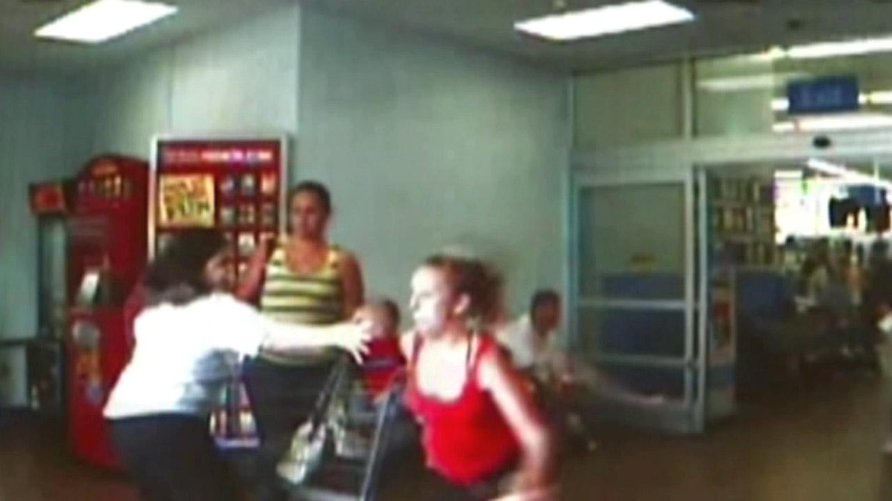Police say 19-year-old Allison Niemeyer (in red), and her sister (in stripes), abandoned Nieymeyeres baby as they fled from an Ocala, Fla., Wal-Mart they had tried to steal from in July 2012.