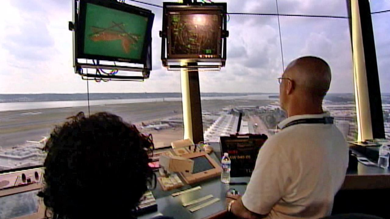 Air traffic controllers appear in this undated file photo.