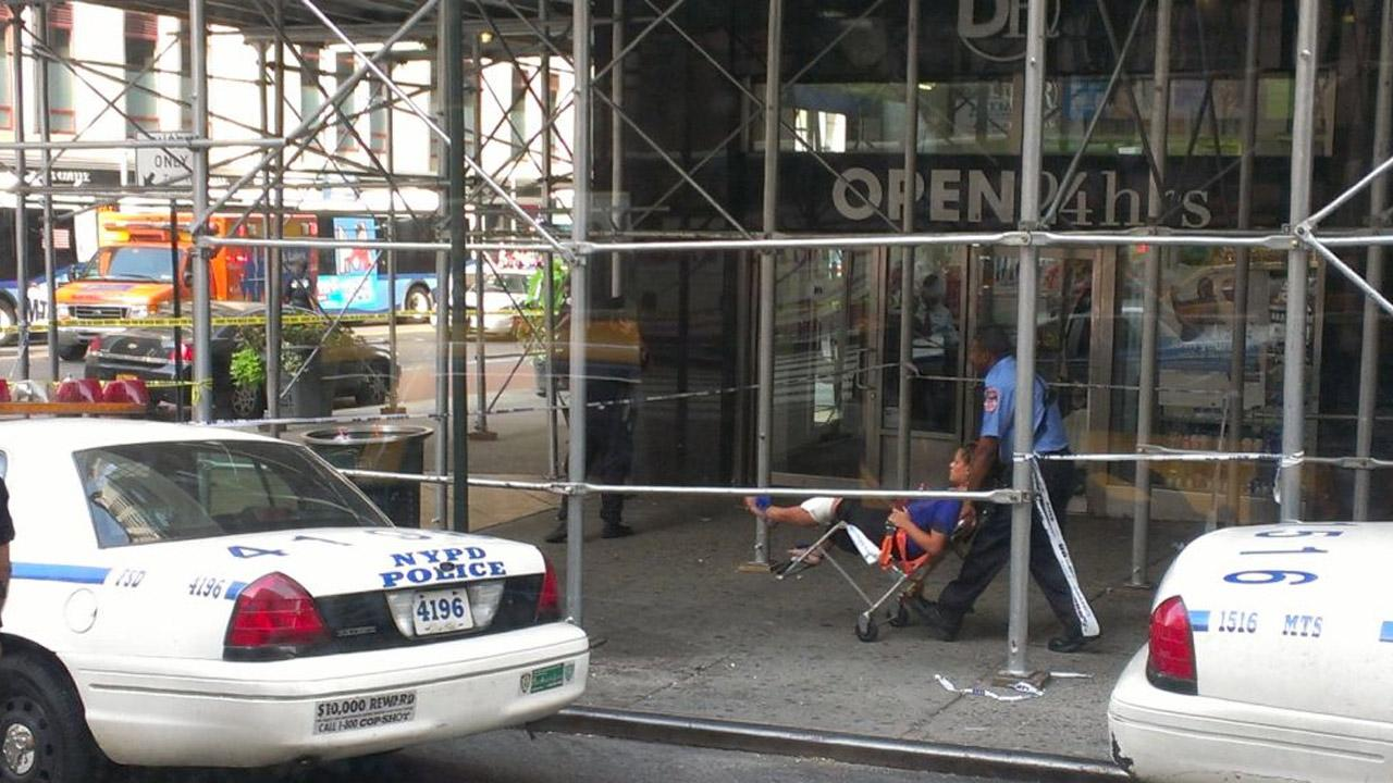 Emergency crews help an injured person at the scene of a shooting outside the Empire State Building on Friday, Aug. 24, 2012. <span class=meta>(twitter.com&#47;richrose)</span>