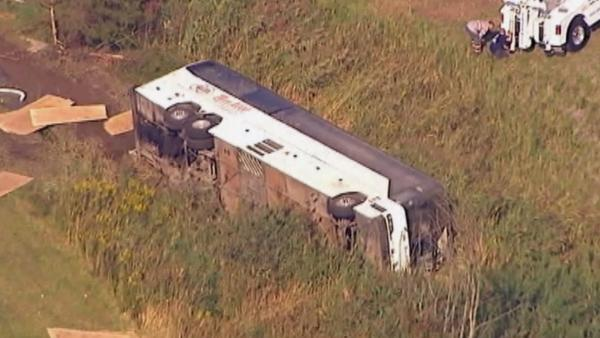 Canadian charter bus overturns exiting New Jersey highway ramp
