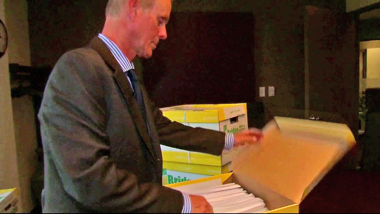 Portland, Ore. attorney Kelly Clark is seen opening a box of the perversion files, released by the Boy Scouts of America on Thursday, Oct. 18, 2012. Clark sued in Oregon Supreme Court to have the file released, and the court rule in his favor.
