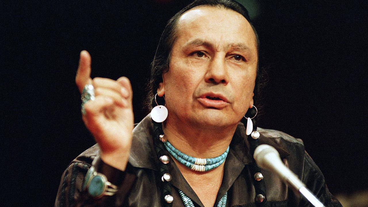 In a Jan. 31, 1989 file photo, Russell Means testifies before a special investigative committee of the Senate Select Committee on Capitol Hill, in Washington.Marcy Nighswander