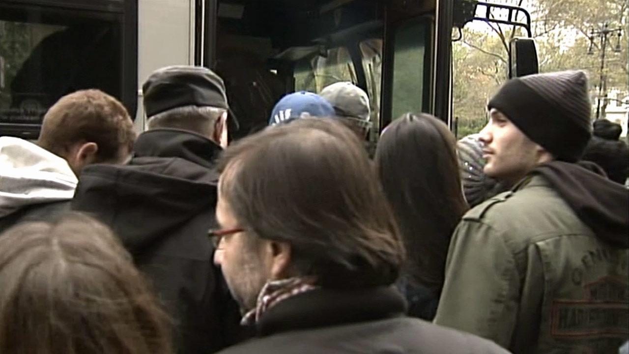 People wait to board a bus heading into Manhattan from Brooklyn on Thursday, Nov. 1, 2012.