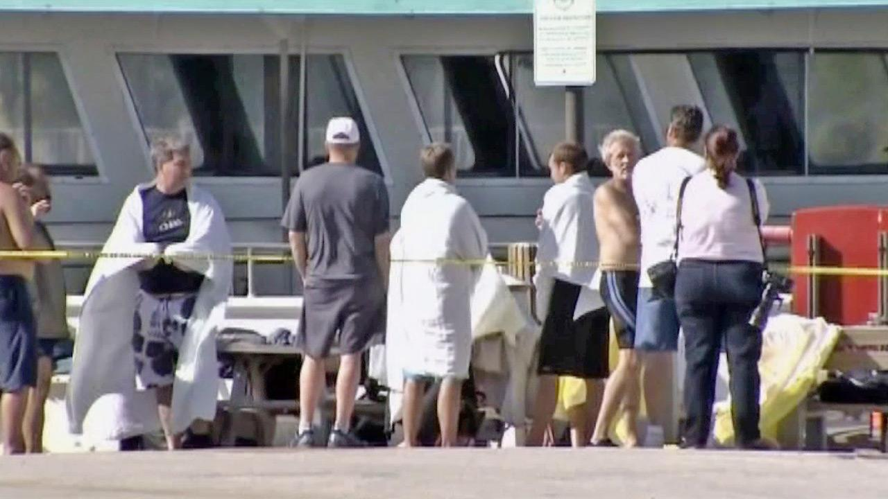 A group of passengers is seen after they were rescued from a capsized boat off the coast of Florida on Thursday, Nov. 23, 2012.