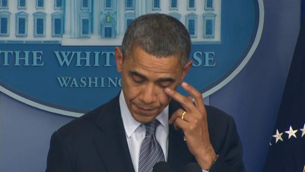 President Barack Obama wipes away tears as he addresses the nation from the White House on the mass shooting in Newtown, Conn., on Friday, Dec. 14, 2012.