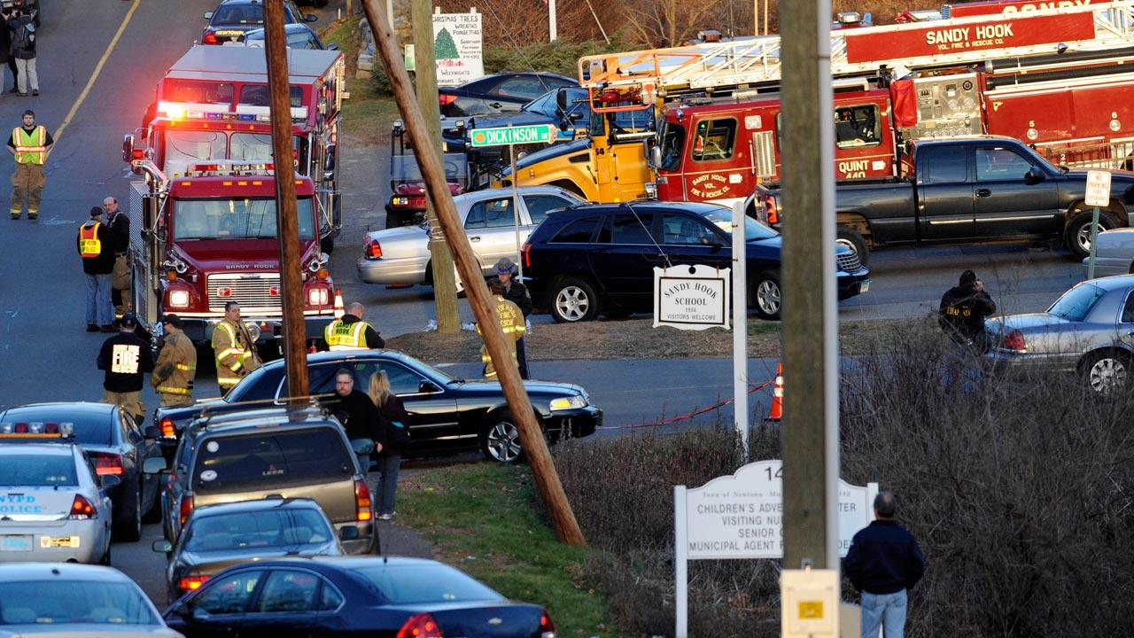 Emergency vehicles line the road at a firehouse staging area for family at the entrance to Sandy Hook School, the site of a school shooting in Newtown, Conn., Friday, Dec. 14, 2012.Jessica Hill