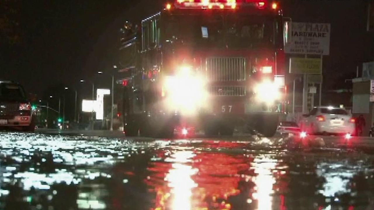 A fire truck is seen on a flooded South Los Angeles street on Thursday, Dec. 27, 2012.