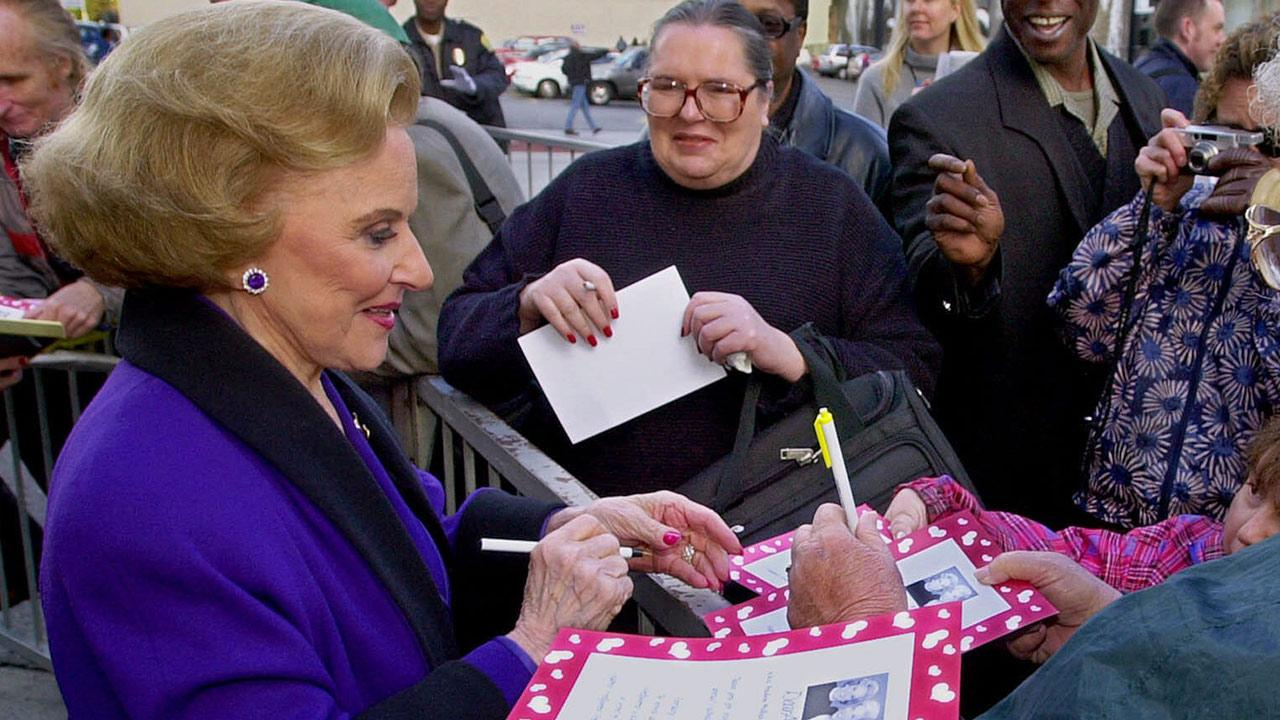 In this Feb. 14, 2001 file photo, Dear Abby advice columnist Pauline Friedman Phillips signs autographs for fans after the dedication of a Dear Abby star on the Hollywood Walk of Fame in Los Angeles. Phillips died on Wednesday, Jan. 16, 2013.Reed Saxon