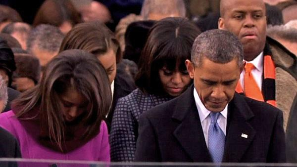 President Barack Obama bows his head during the benediction at the ceremonial swearing-in on the West Front of the U.S. Capitol during the 57th Presidential Inauguration in Washington, Monday, Jan. 21, 2013.