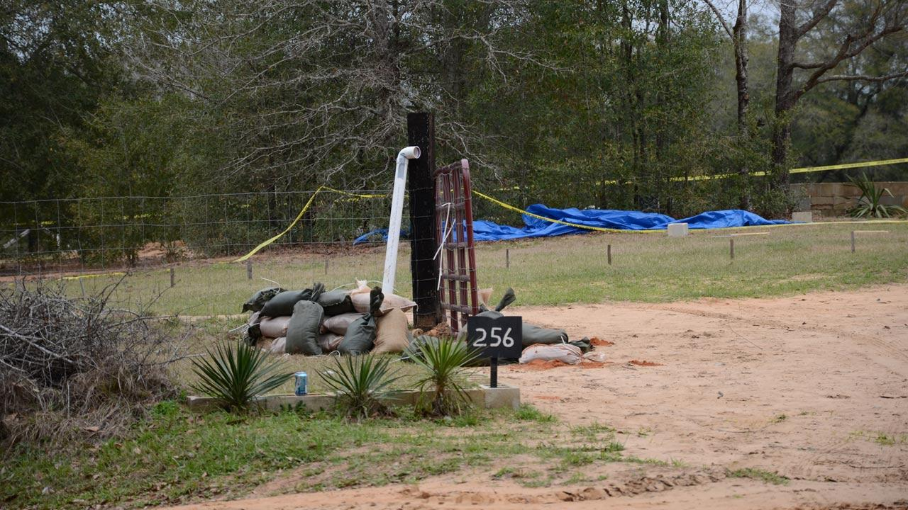 A tent covers the bunker where where a 5-year-old boy was rescued by law enforcement after being held for nearly a week. FBI agents placed the blue tent over the bunker to protect evidence below.